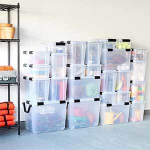 Plastic totes for storing Christmas decorations. photo
