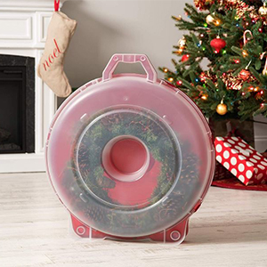 Round storage container for holiday wreaths. photo