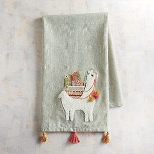 Mint colored tea towel with orange tassels on the bottom and a llama on it photo