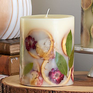 A candle with grapefruit slices, leaves, and flowers inside from White Flower Farm photo