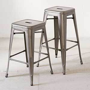 This sturdy steel barstool set comes with rubber feet so your tile or hardwood is protected as you slide them in and out. photo