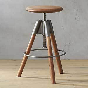 Made of beautiful acacia wood, the seat of this barstool twists up and down seven inches, so whether you have tall counters or a short island, this stool fits right in. photo