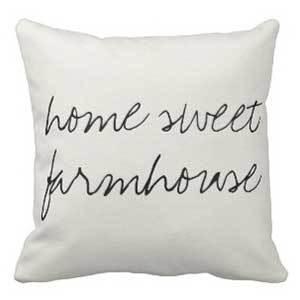 Off-white throw pillow with cursive lettering that reads home sweet farmhouse photo