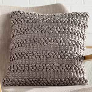 Metallic gray throw pillow with alternating stripes of loops photo