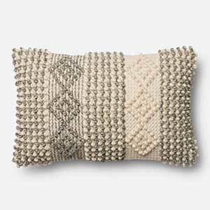 Geometric textured throw pillow with a mixture of creams, beige, and khakis photo