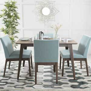 The set comes in oak or walnut and multiple fabric options, but we are loving the sophisticated look of the Tiffany Blue fabric paired with walnut finishes. photo