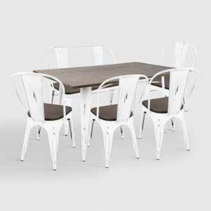 Deep brown colors paired against white, like in this dining collection, warm up your space while still encompassing the trend. photo