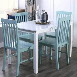 The vertical slat design of the chairs complement the straight-line style of the table. photo