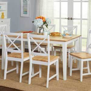 The light-colored wood paired against white paint will brighten up your space while the crossback design on each chair back completes the country-chic aesthetic. photo