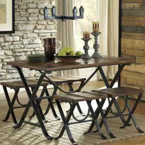 A wooden oak tabletop sits above solid metal legs to create a sturdy dining room set. The cross