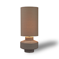 Brown table lamp with tire-shaped base and tall, thin cloth shade photo