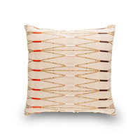 Tan throw pillow with red, purple, and gold pattern photo