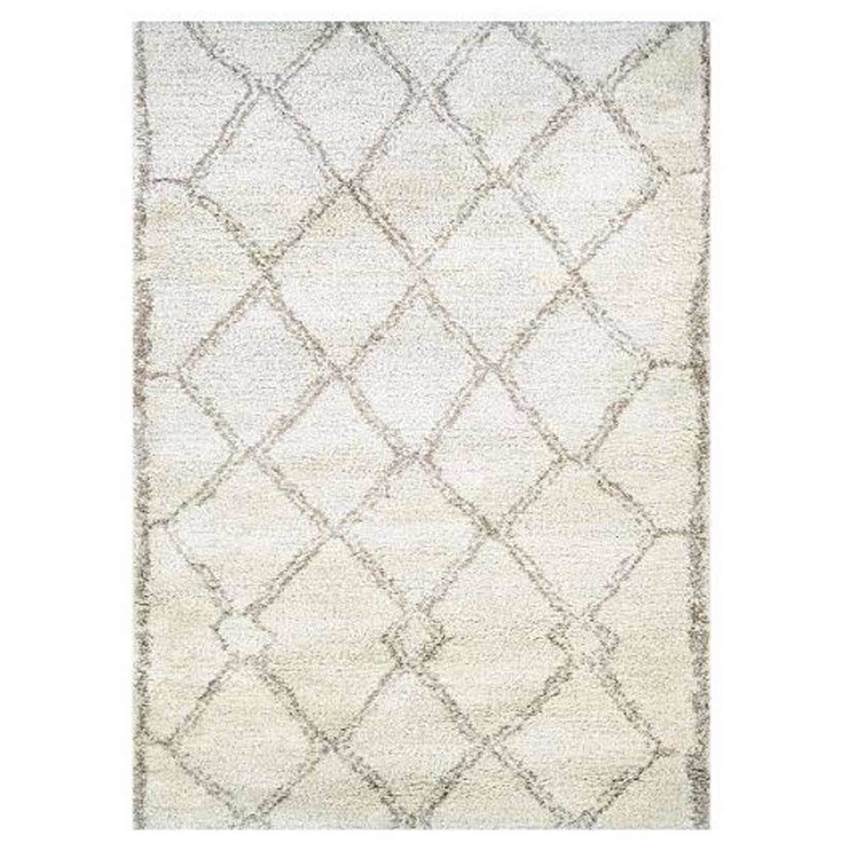 white and bronze patterned rug from Macy's photo