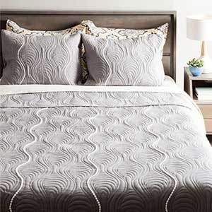 Gray quilt with a unique wave pattern photo