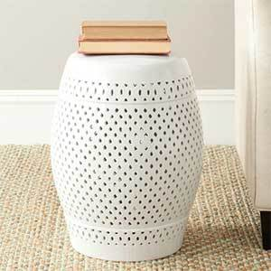 White garden stool with a punch-hole pattern photo