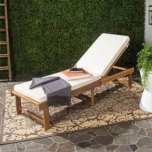 Wood chaise lounge chair with a white cushion photo