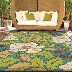 Coloful rug with a large floral pattern photo