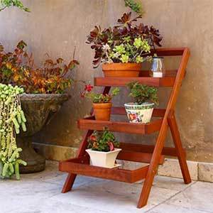 Three-tier plant stand made from wood photo