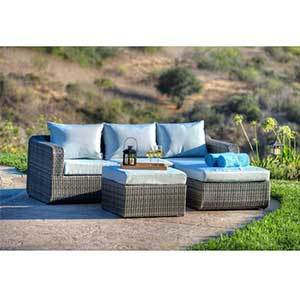 Overstock wicker patio set including a sofa and ottoman photo