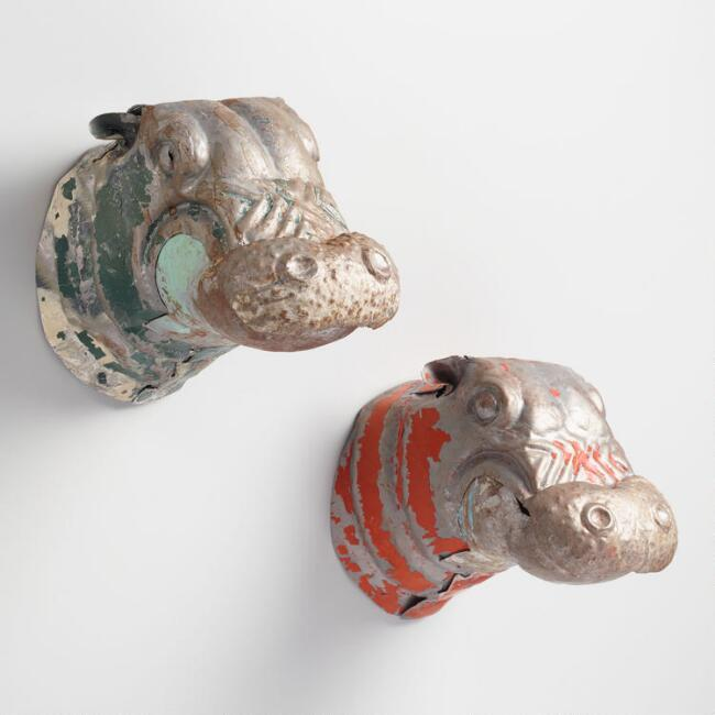 Red and Green Metal Hippo Busts photo