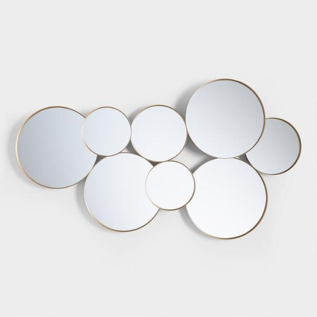 Set of round wall mirrors grouped together photo