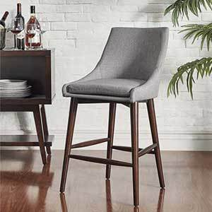 Upholstered counter stool in gray with back photo