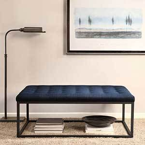 Navy upholstered tufted ottoman photo
