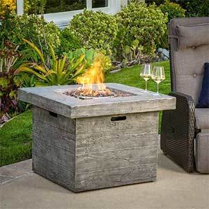 Overstock steel outdoor fire pit with lava rocks photo