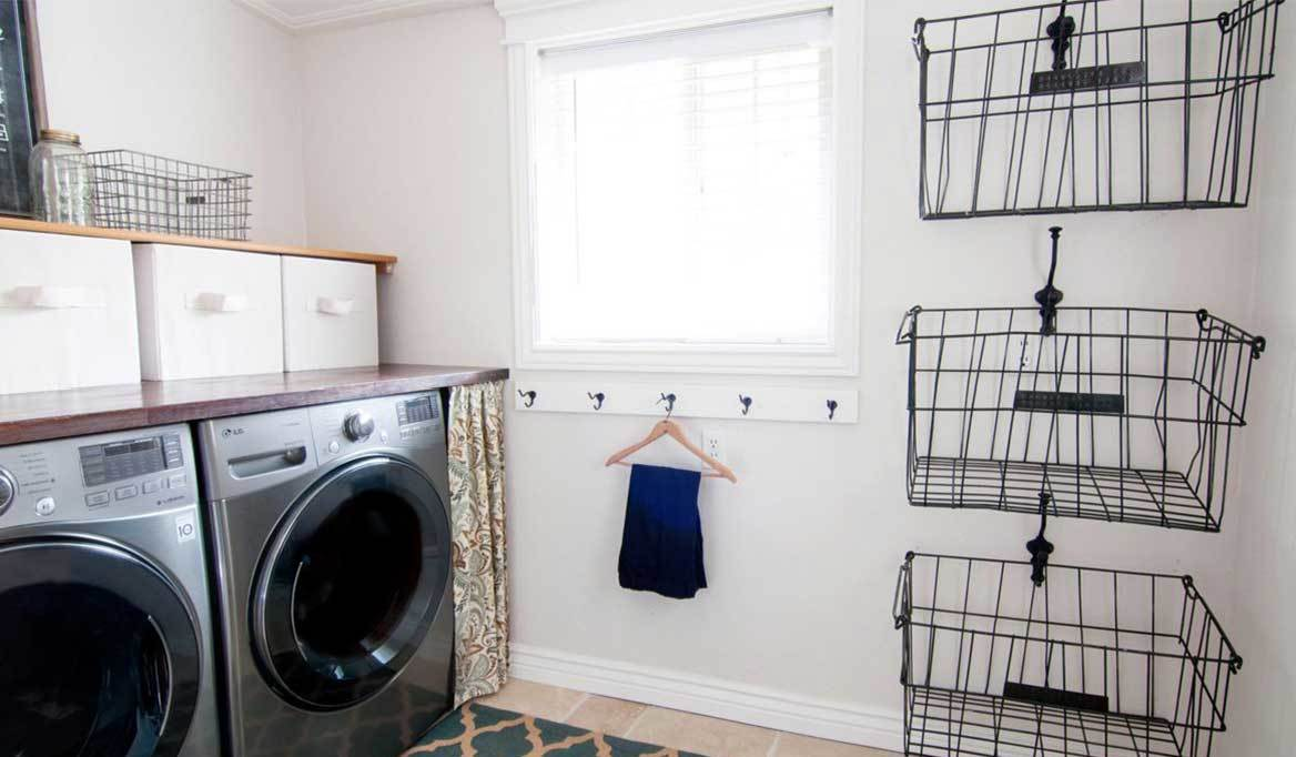 Laundry room storage including wire baskets, hooks, and cubes.