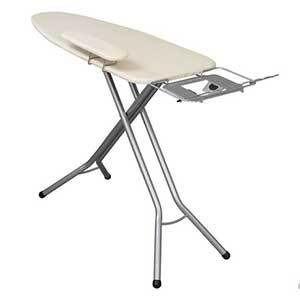 Ironing board with a mini board attached for ironing sleeves. photo