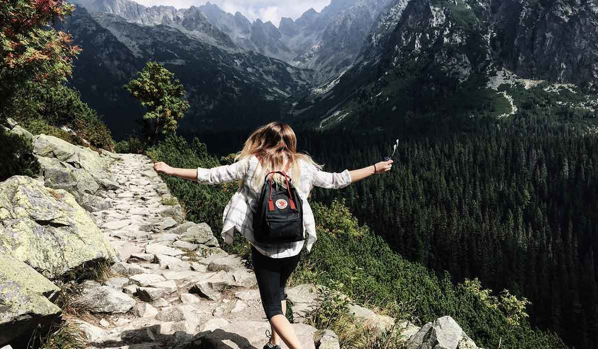 Woman hiking on her honeymoon in the mountains