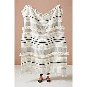 Throw blanket with a striped design and fringed detail photo