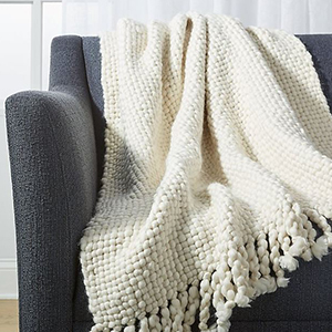 CB2 hand-knitted blanket photo