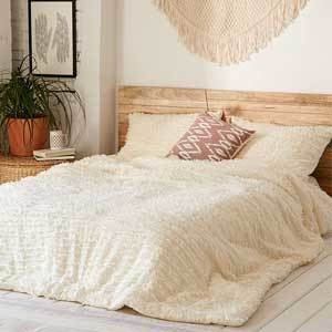 Urban Outfitters cotton comforter with fringe photo