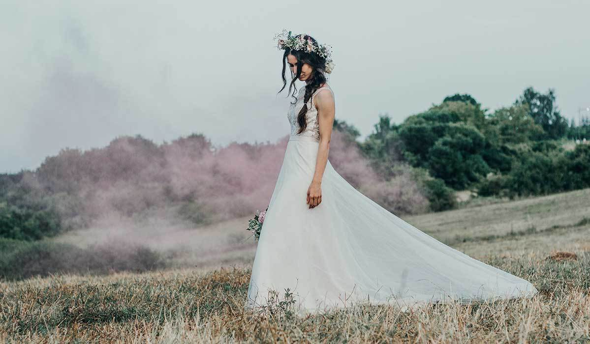 Woman in wedding dress in nature