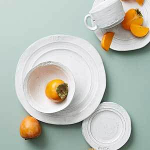 Anthropologie white dinnerware set with plates and bowls photo