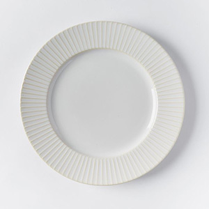 West Elm four-piece dinnerware set with textured edge photo