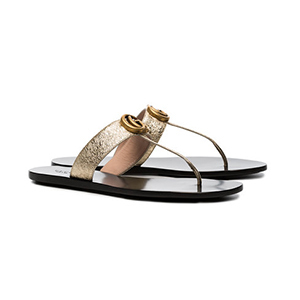 gold and black Gucci Sandals from Farfetch photo