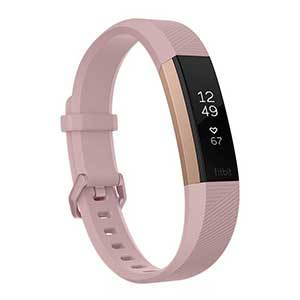Fitbit Alta HR with a slim pink band. photo