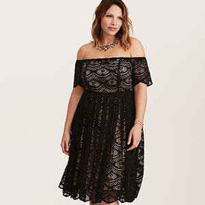 Woman wearing an off-the-shoulder black dress photo