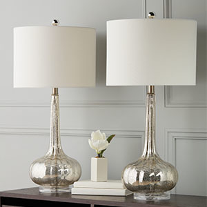 Set of two silver mercury antiqued table lamps with ivory shades. photo