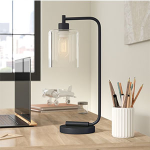 Industrial-modern table lamp with matte black finish and clear glass shade. photo
