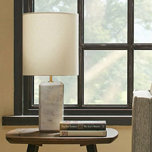 Modern marble table lamp with white lampshade. photo