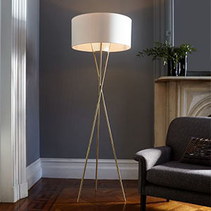 Midcentury-modern tripod floor lamp with brass finished base and white linen shade. photo