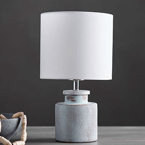 Farmhouse-inspired table lamp with a rubbed-glazed base and LED bulb. photo