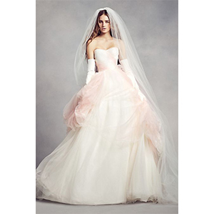 Bride in ombre blush wedding dress, gloves, and veil photo