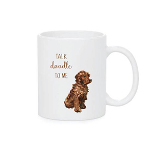 White coffee mug with a Goldendoodle on it photo