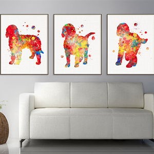 Trio of wall prints with goldendoodles on them photo