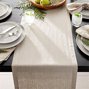 Beige linen table runner on set table from Crate & Barrel photo