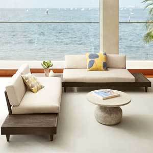 Beige sofa set with connected wood side tables photo